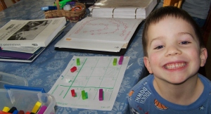 Look at that smile! He loves his math:)