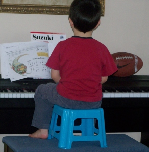 This is the way a 4 year old plays the piano!