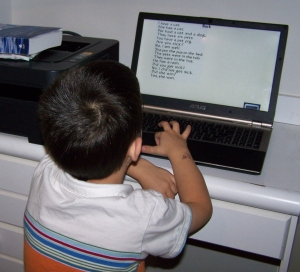 Loves his computer school time!