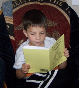 Reading his very own book!
